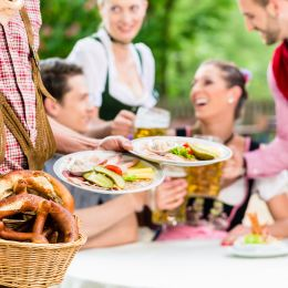Waiter serving food in Bavaria, Germany Tours, Europe