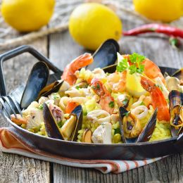 Tasty Spanish paella with seafood and chicken breast