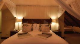 Bedroom at Ilala Lodge Hotel in Victoria Falls, Zimbabwe