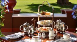 Terrace afternoon tea at Victoria Falls Hotel, Victoria Falls Zimbabwe, Africa