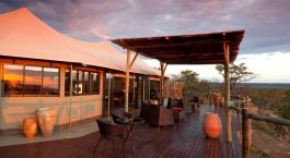 Exterior view by night at Elephant Camp in Victoria Falls, Zimbabwe