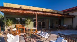 Outdoor seating area at Club Tapiz Boutique Hotel, Mendoza, Argentina