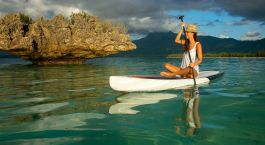 Young beautiful girl riding on clear waters of the Indian Ocean of Mauritius