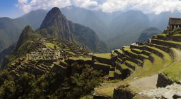 Panorama of Machu Picchu, Guard house, agriculture terraces, Wayna Picchu and surrounding mountains in the background