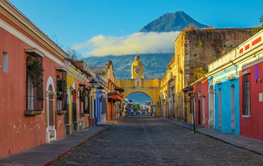 Enchanting Travels Guatemala Tours Antigua Cityscape in the main street of Antigua city with the Agua volcano in the background