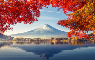 Enchanting Travels Japan Tours Colorful Autumn Season and Mountain Fuji with morning fog and red leaves at lake Kawaguchiko is one of the best places in Japan