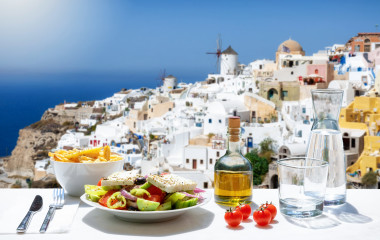 Greece private trip: Tasty Greek food with salad, fried potatoes and fresh olive oil at Oia in Santorini