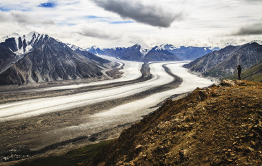 Hiker photographing beautiful Kaskawulsh Glacier in Kluane National Park, Yukon, Canada