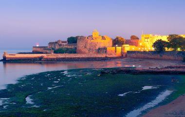 Enchanting Travels India Tours Fort Diu at night. Daman and Diu, India Asia