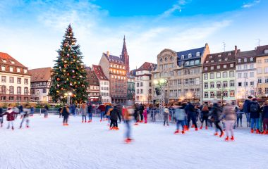 Enchanting Travels France Tours Ice Skating near the Cathedral in Strasbourg