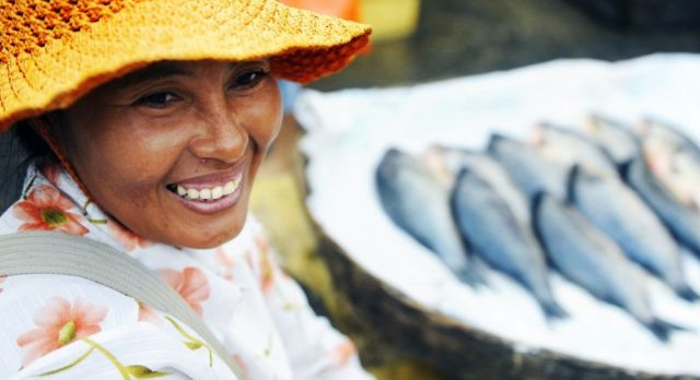 Indigenous Cambodian woman selling fish in a market, Asia