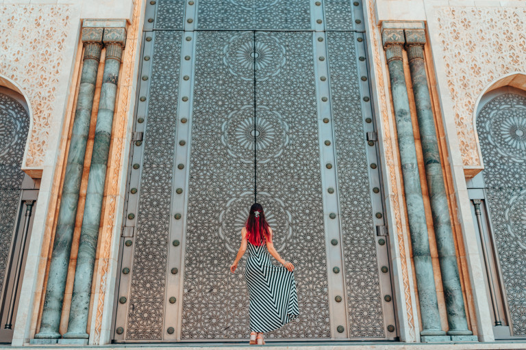 Morocco travel guide - Girls standing in front of greatest mosque Hasan II in Morocco, Africa - Top six destinations we can't wait to visit again