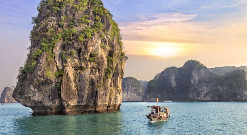 Dreamy sunset among the rocks of Halong Bay, Vietnam Asia