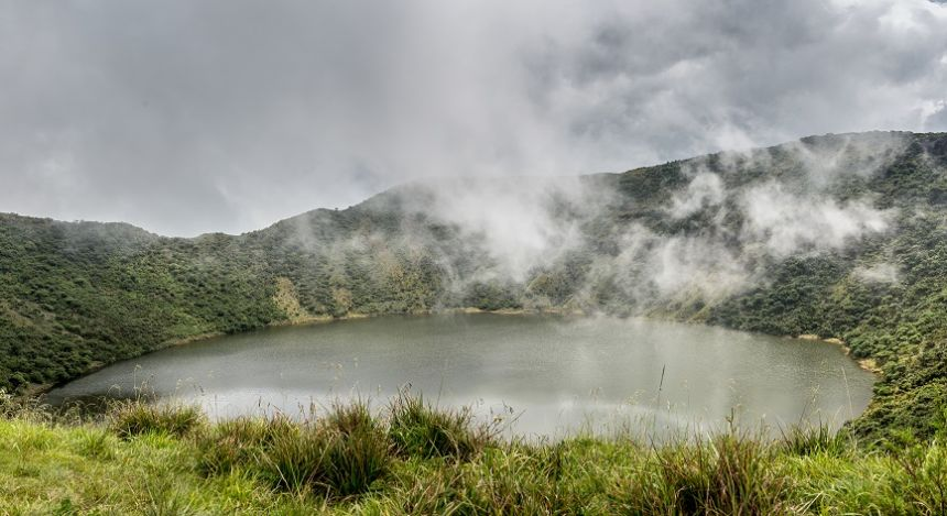 Enchanting Travels African safari parks to see - Lake inside Bisoke volcano crater, Virunga volcano national park, Rwanda