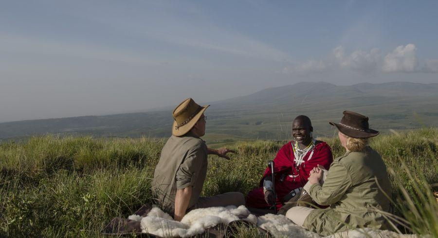 Highlands-Ngorongoro-guests-maasai-guide-picnic-Eliza-Deacon-2-HR