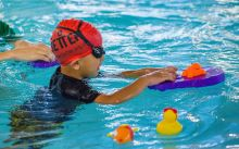 Child learning to swim with Better
