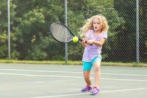 Little girl playing tennis