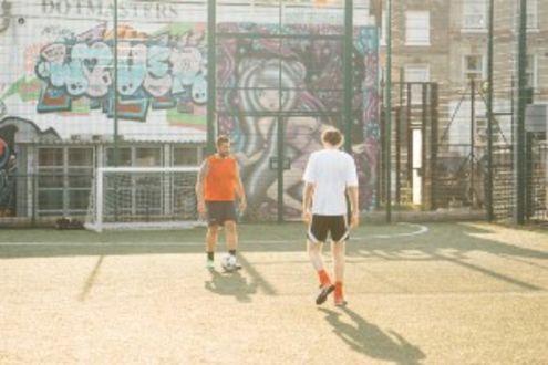 Boys playing football outside