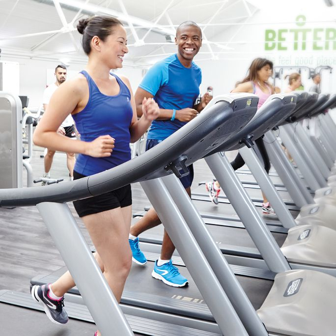 young man and young woman on treadmill