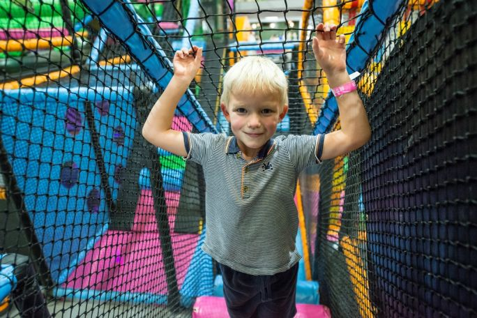 Young boy enjoying the soft play