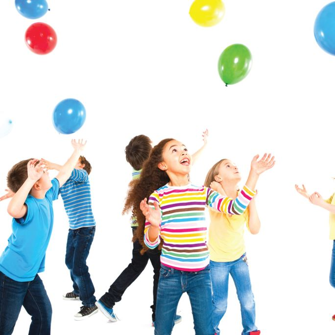 Children playing with balloons at a birthday party