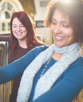 Two ladies looking at books