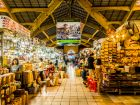 line of stalls inside a flea market