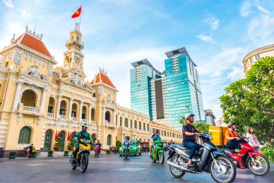 people on motorbikes in city center saigon