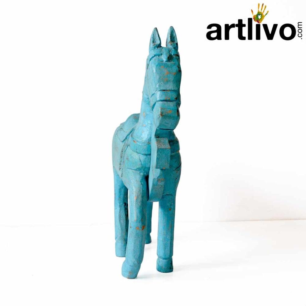 Wooden horse statue blue