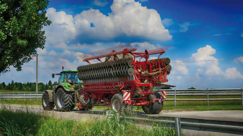Kverneland DG2 compact transported by tractor on road
