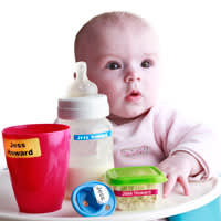 Baby with a selection of labels on bottles