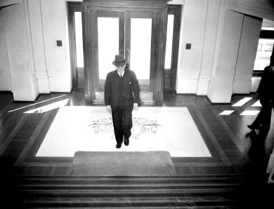 Prime Minister John Curtin enters Parliament House, Canberra on 3 July 1942, ahead of a press conference