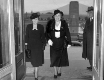 Dorothy Tangney and Enid Lyons walk through the doors of Parliament House in 1943 as its first female politicians. Photo: Australian War Memorial.