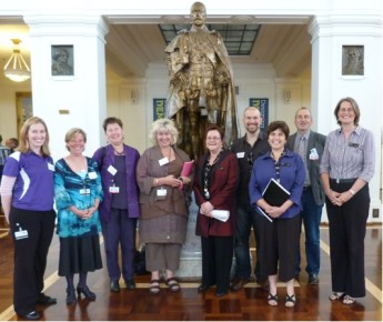 Director of the Museum Jenny Anderson welcoming the members of the Disability Reference Group in King's Hall. Left to right: Heather Bozza (Vision Australia), Janette Griffin (Old Parliament House Advisory Council), Kris Newton (Deafness Forum of Australia), Angie Ingram (Mental Health Foundation ACT), Jenny Anderson (Director, MoAD), Jim McGrath (NICAN), Glenda Smith (Chair of the DRG, MoAD), Mark Pattison (National Council on Intellectual Disabilities), Kate Armstrong (MoAD). Absent: Justyn McDonald (National Disability Services).