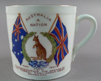 Colourful souvenir mugs were manufactured in Britain by Aynsley and carefully transported to Australia for the opening of Parliament House in 1927. The design on the front of the mug shows a kangaroo with tiny joey in pouch encircled by a wreath and Australian and British flags. The inscription at the top proudly proclaims 'AUSTRALIA A NATION' despite Australia becoming a nation in 1901. Image: Museum of Australian Democracy Collection