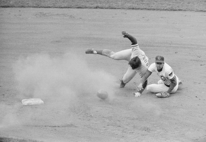 Don Kessinger forces out Pete Rose, who then takes a tumble across the second base bag.