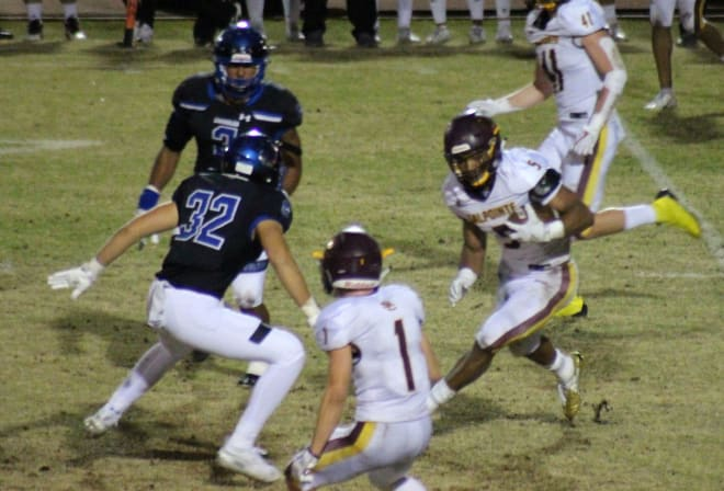 Salpointe running back Bijan Robinson gains some yards as Chandler linebacker Tate Romney (32) closes in. Last month marked the first time 4A teams met 6A ones in the playoffs.