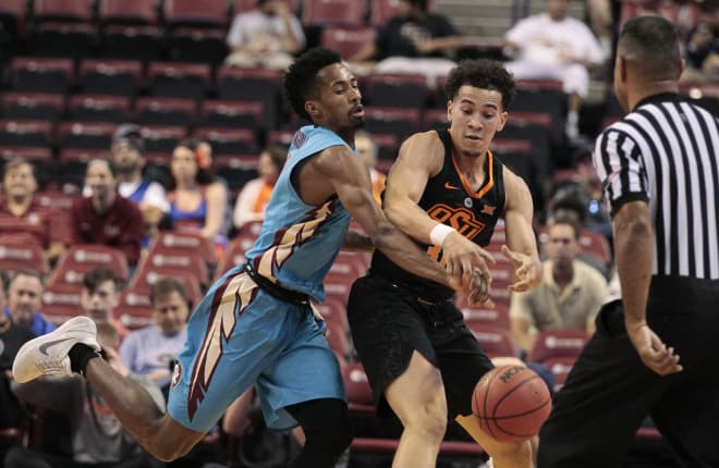 FSU guard Braian Angola deflects the ball from the hands of Oklahoma State's Jeffrey Carroll.