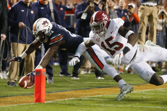Auburn Tigers running back Kerryon Johnson (21) reaches for the pylon as Alabama Crimson Tide defensive back Ronnie Harrison (15) during the third quarter at Jordan-Hare Stadium. Photo | USA Today