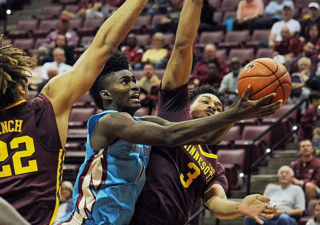 Freshman forward Jonathan Isaac drives in for a basket in his team's win over Minnesota on Monday.