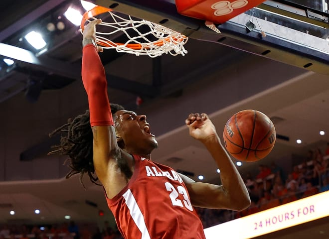 Alabama Crimson Tide junior John Petty Jr. dunks in the first half at Auburn on Wednesday, Feb. 12.  (Photo by Kevin C. Cox/Getty Images)