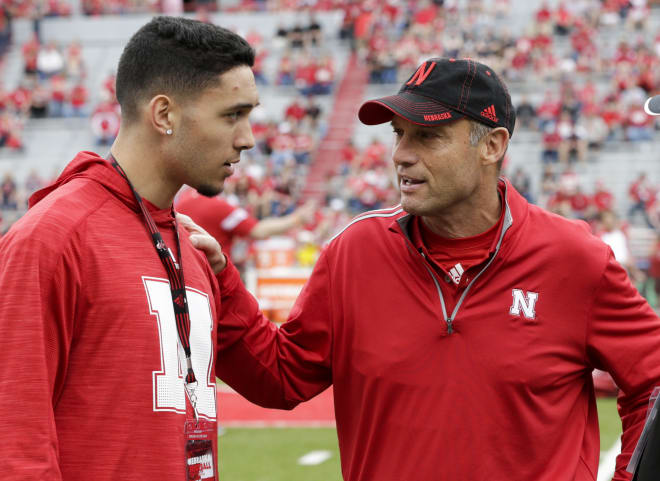 Mike Riley chats with recruiting prospect Talanoa Hufanga at Nebraska's spring game.
