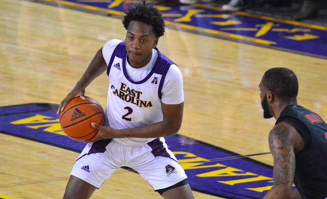 Tristen Newton was the man of the hour with nine of his eleven points in the second half including three treys and the game winner in ECU's 71-68 victory over SMU Saturday afternoon in Minges Coliseum.
