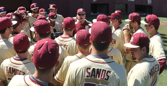 FSU coach Mike Martin talks to his players before Sunday's series finale against Rhode Island.