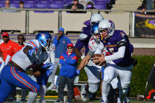 East Carolina quarterback Gardner Minshew picks up positive yardage in Saturday's loss to SMU.