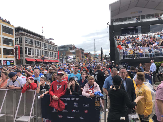 Fans lined Broadway for the NFL Draft's first round on Thursday night.