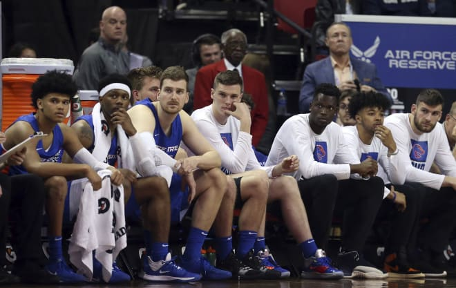The Boise State bench watches during the final moments of the team's NCAA college basketball game against San Diego State in the Mountain West Conference men's tournament Friday, March 6, 2020, in Las Vegas.