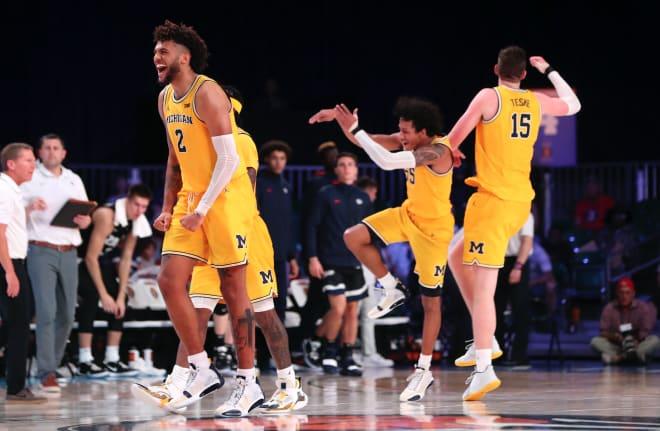 Michigan Wolverines basketball junior forward Isaiah Livers yelling