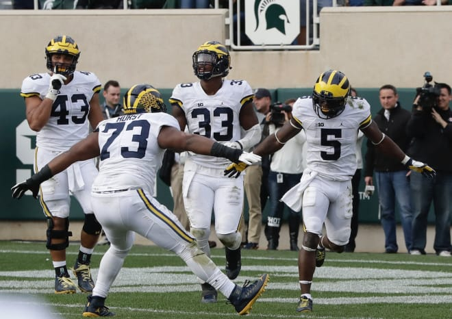 Michigan player takes cleats to Michigan State logo after pregame altercation