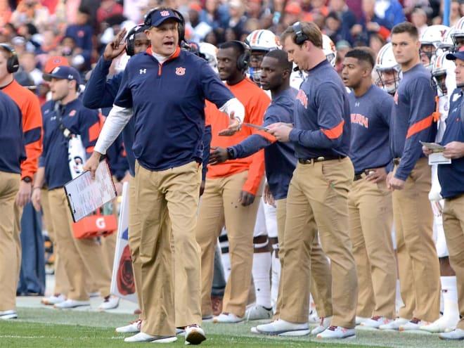 Auburn coach Gus Malzahn objects to new 20 headset limit
